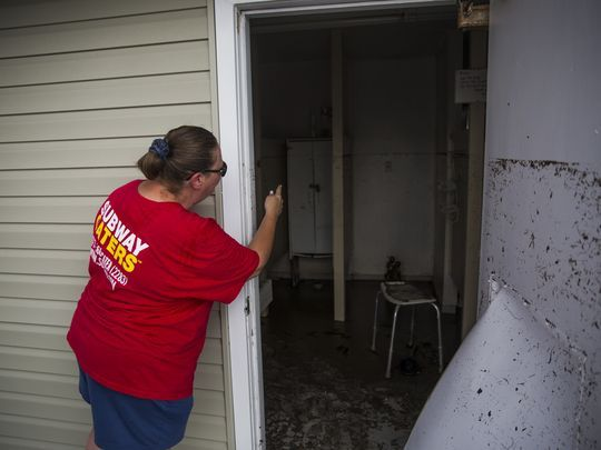 Carmen Kiefer, a resident of Fisherman's Cove RV Park, opens the door to the public bathroom on Thursday, September 21, 2017 in Everglades City. (Photo: Katie Klann/Naples Daily News)