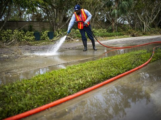 Darryl Jones, of St. Petersburg, sprays sewage on Mahogany Bend Drive into a vacuum truck in Naples on Thursday, September 14, 2017.(Photo: Justin Gilliland/Special to the Naples Daily News)