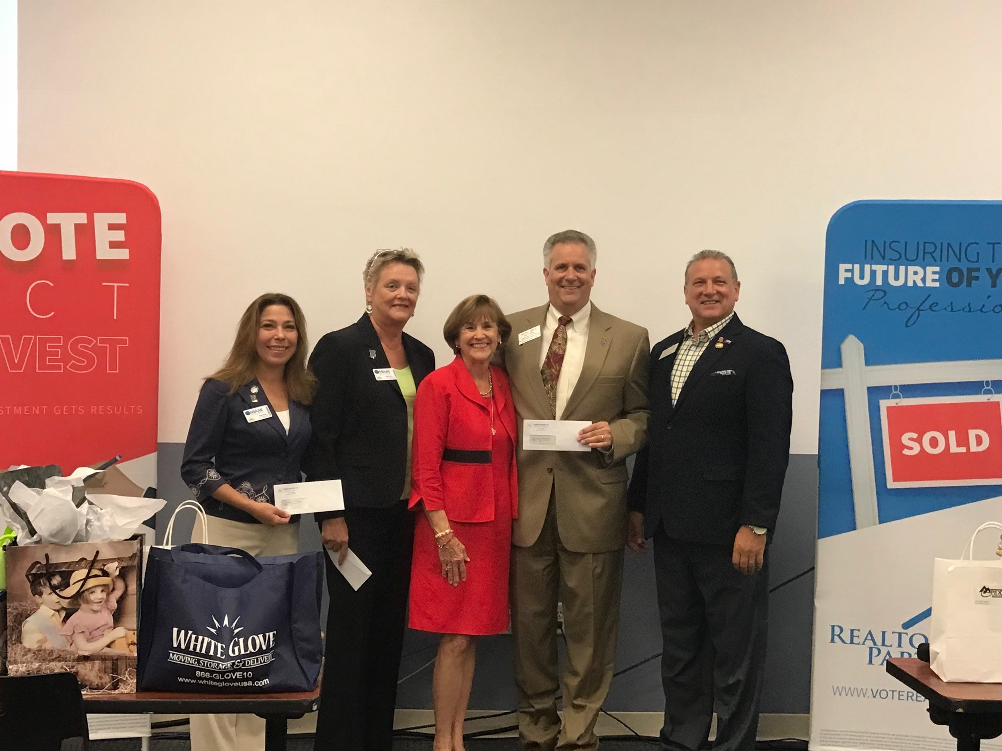 Left to Right: Kim Price and JTHS Council of Realtors® President Barb Fox, Candidate for Florida Senate District 25 Gayle Harrell, RAPB+GFLR Immediate Past President John Slivon and St. Lucie County Government Affairs Chair Anthony Gambardella