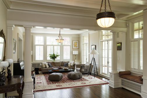 The Living Room of  The Knollwood  today—at Genuine Antique Lighting in Boston we found beautiful bronze trimmed milk glass light fixtures from the Edwardian era; the restored interior offsets the owner's contemporary furniture.