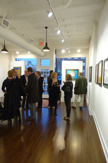Time to mingle after the crowd checks out the posters opening night at the Bahr Gallery.