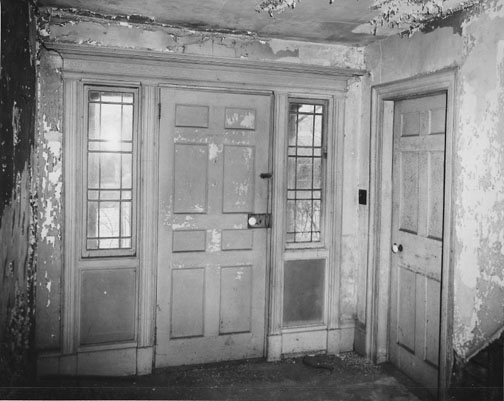 The entry hall as it looked in 1962.  Photo from Preservation Long Island's archive.