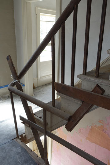 Once the missing pieces are restored, the elegant stair rail will read as one continuous curving piece of wood from the first floor to the attic.
