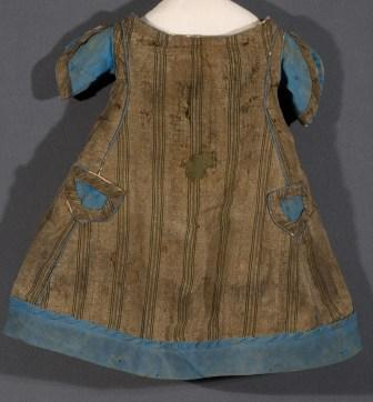 Support patch inserted behind 19th century roller printed fabric on child's dress.