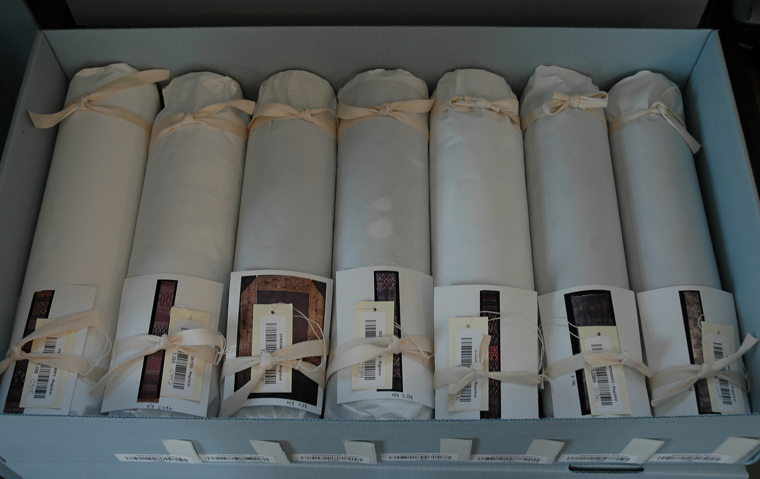 Textiles properly rolled, boxed and labeled for storage