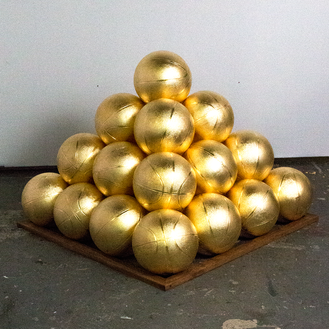 "Victor Solomon, ""Faulhaber Flex."" 2016. 30 gilded basketballs. 48 x 48 x 33 in."