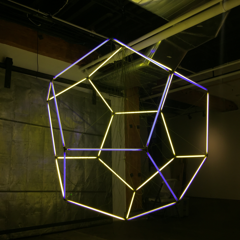 "Jason Peters, ""Kepler's Myster,""  2016. Mixed Media: fluorescent tubes, custom brackets, wire. 96 x 84 x 84 in."