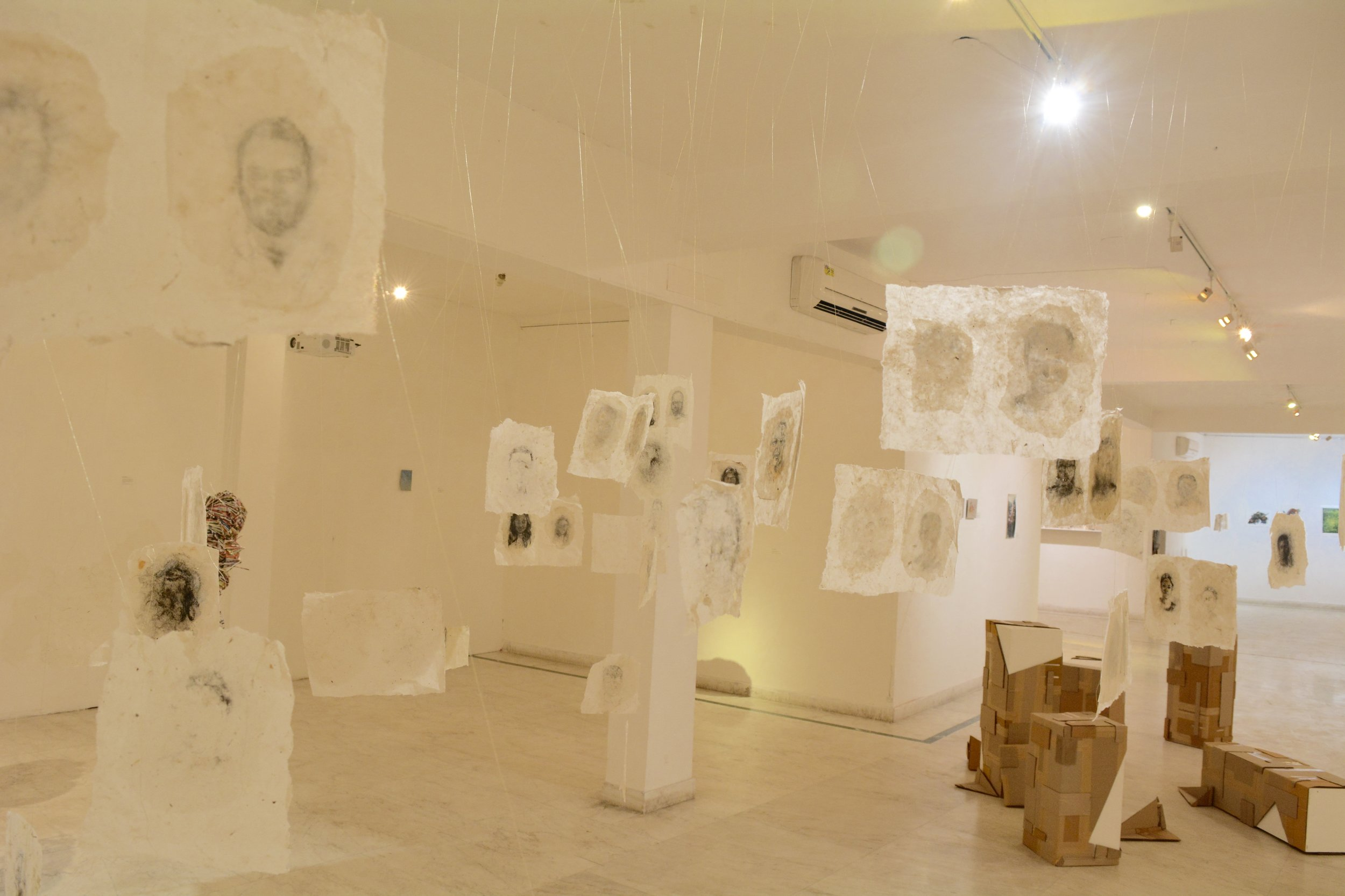 Rice paper hung from gold thread, calling the viewer's attention to our fragility and sacredness