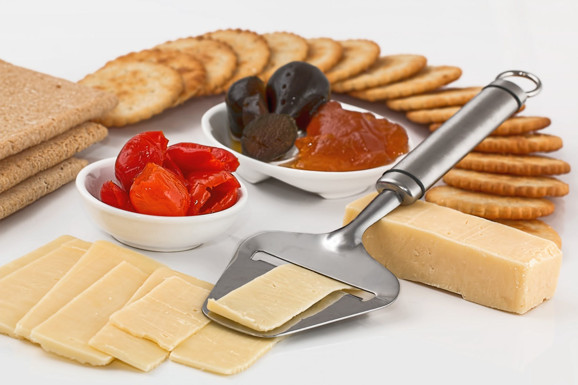 cheese-slicer-crackers-appetizers-dairy-product-37922.jpeg