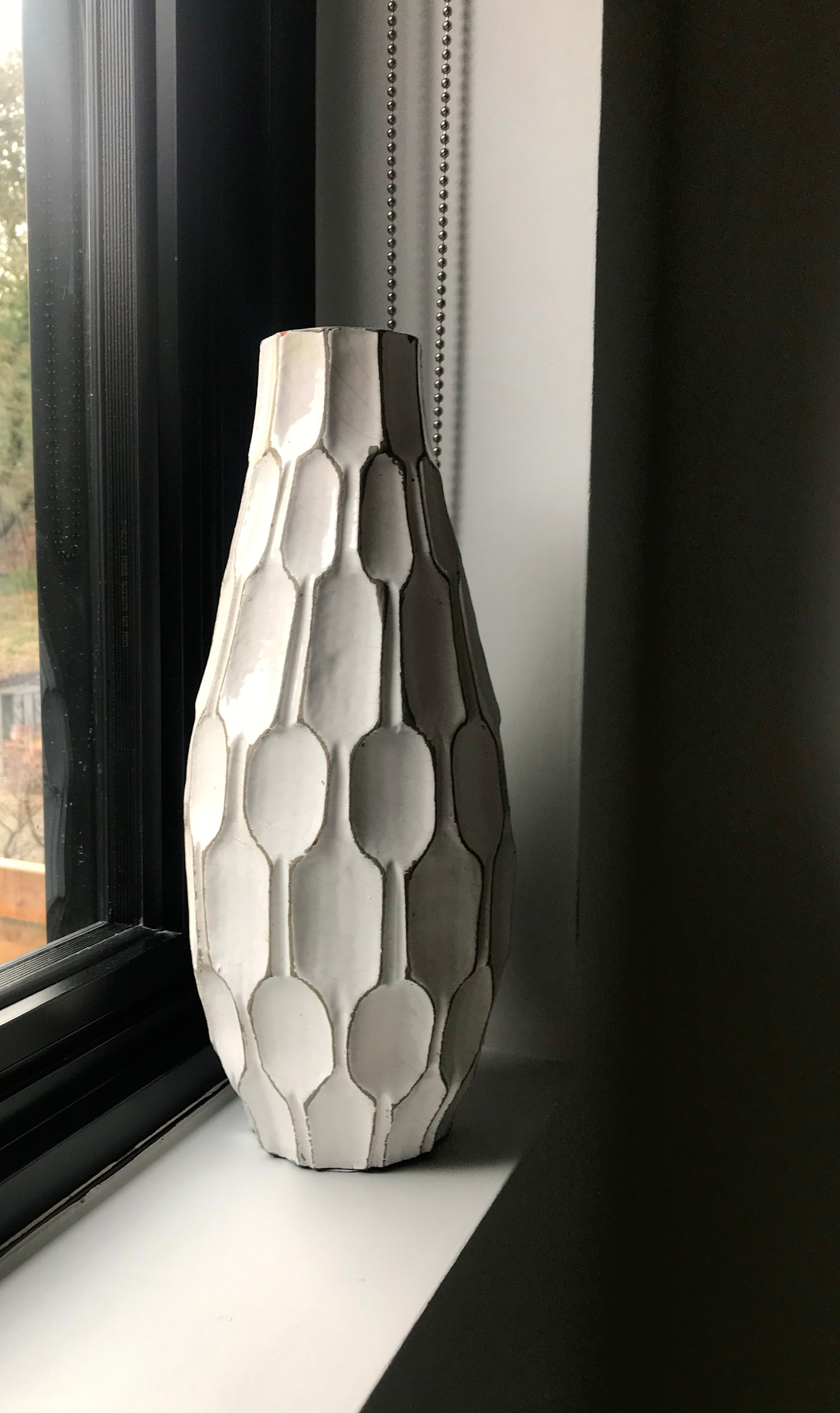 I think this vase from west elm works well here.