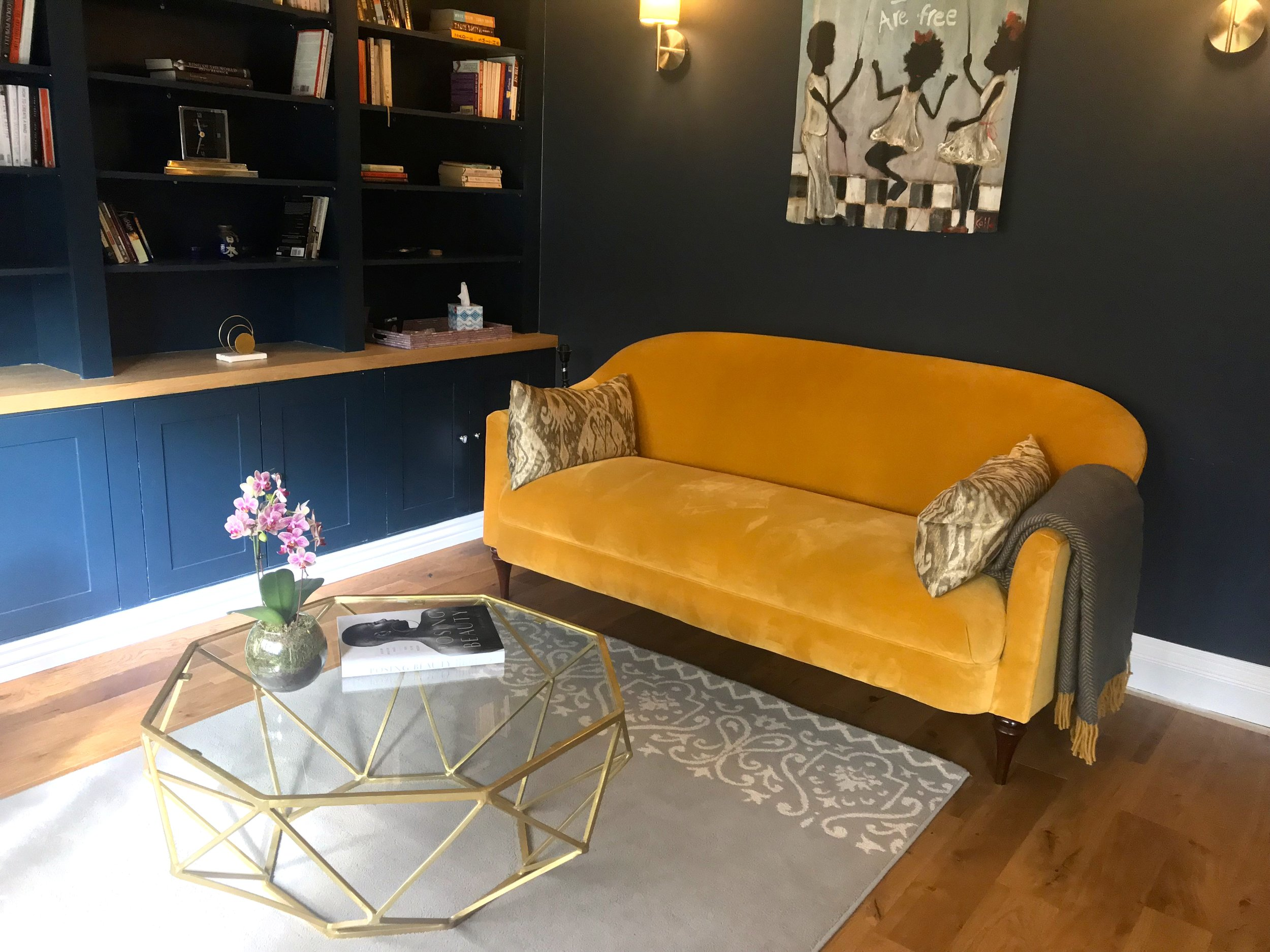 bright yellow sofa to add a pop of colour to the room