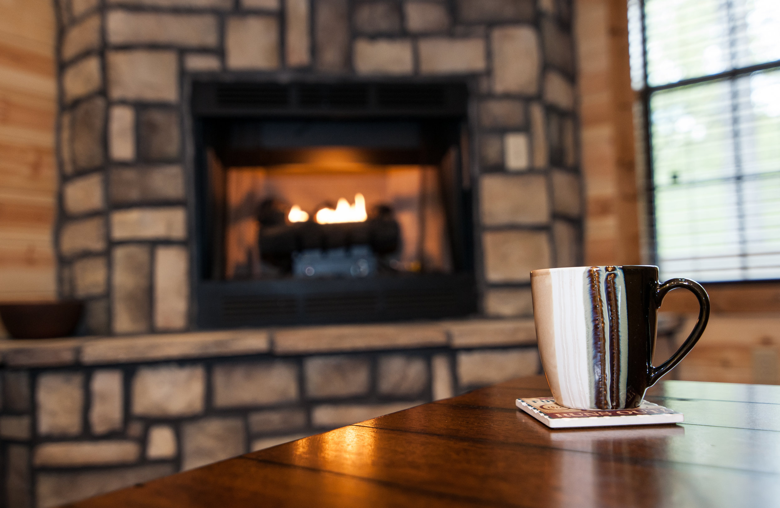 Coffee Cup with fireplace in background.jpg.jpg