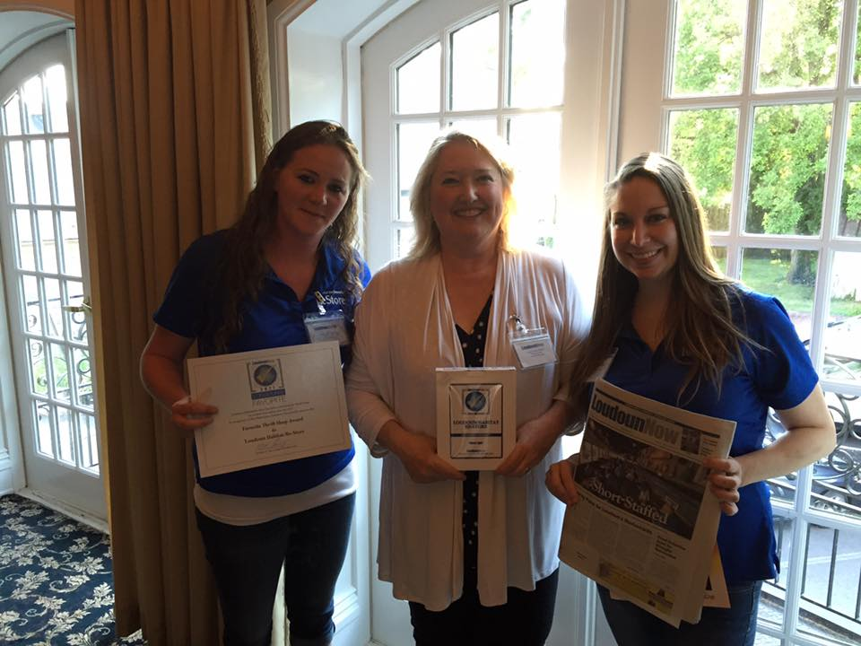 """Loudoun Habitat ReStore representatives receiving the award at Loudoun Now's event for all the 2017 """"favorite"""" winners. Pictured from left to right, ReStore Manager, Kristen Wolfe, Loudoun Habitat For Humanity's Executive Director, Therese Cashen and ReStore Donations Manager, Kellyn Larrabee."""