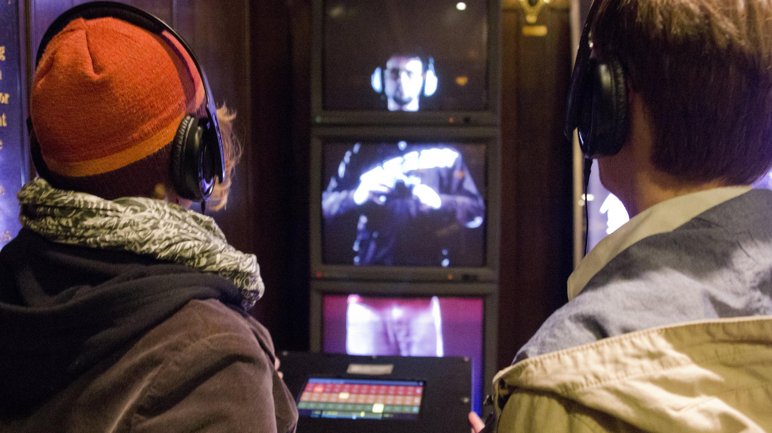 2 people headphones.jpg
