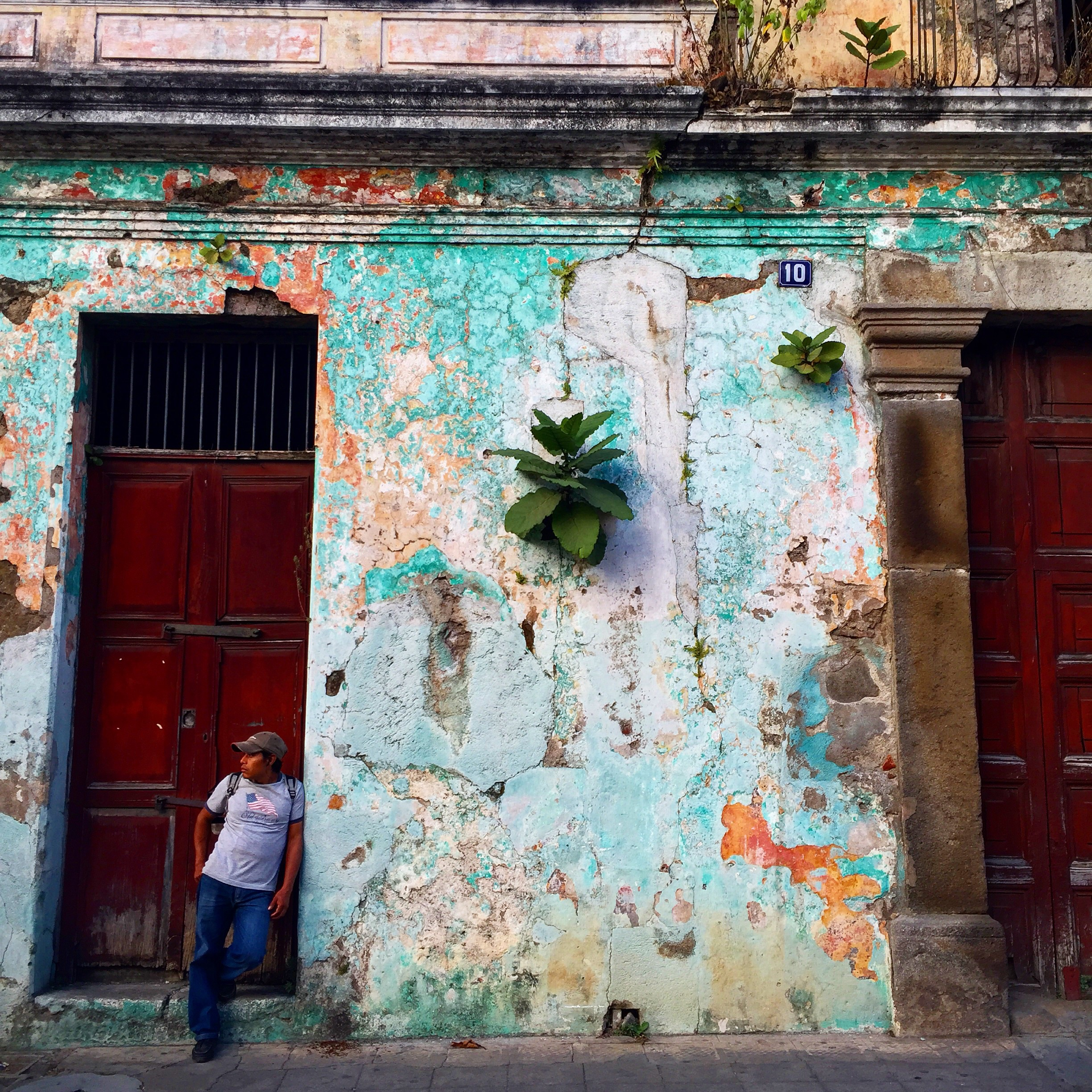 Explore the vibrant streets of Antigua on your way to Lake Atitlan.