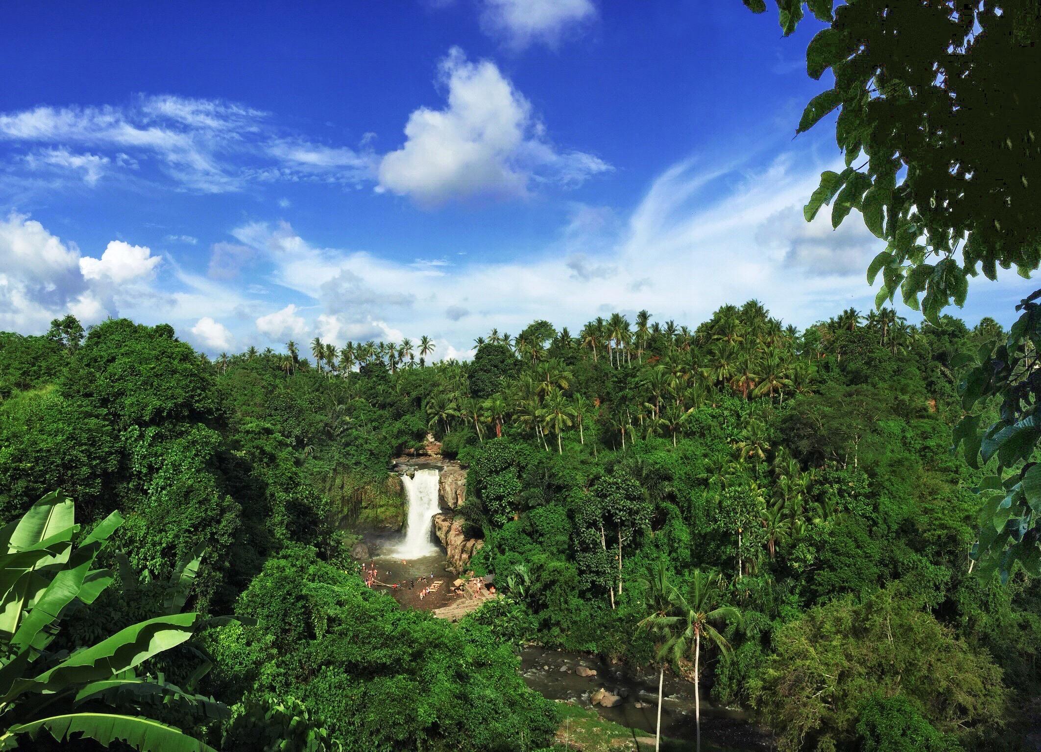 Tegenungan Waterfall cascades over the rock face below near Ubud, Bali.