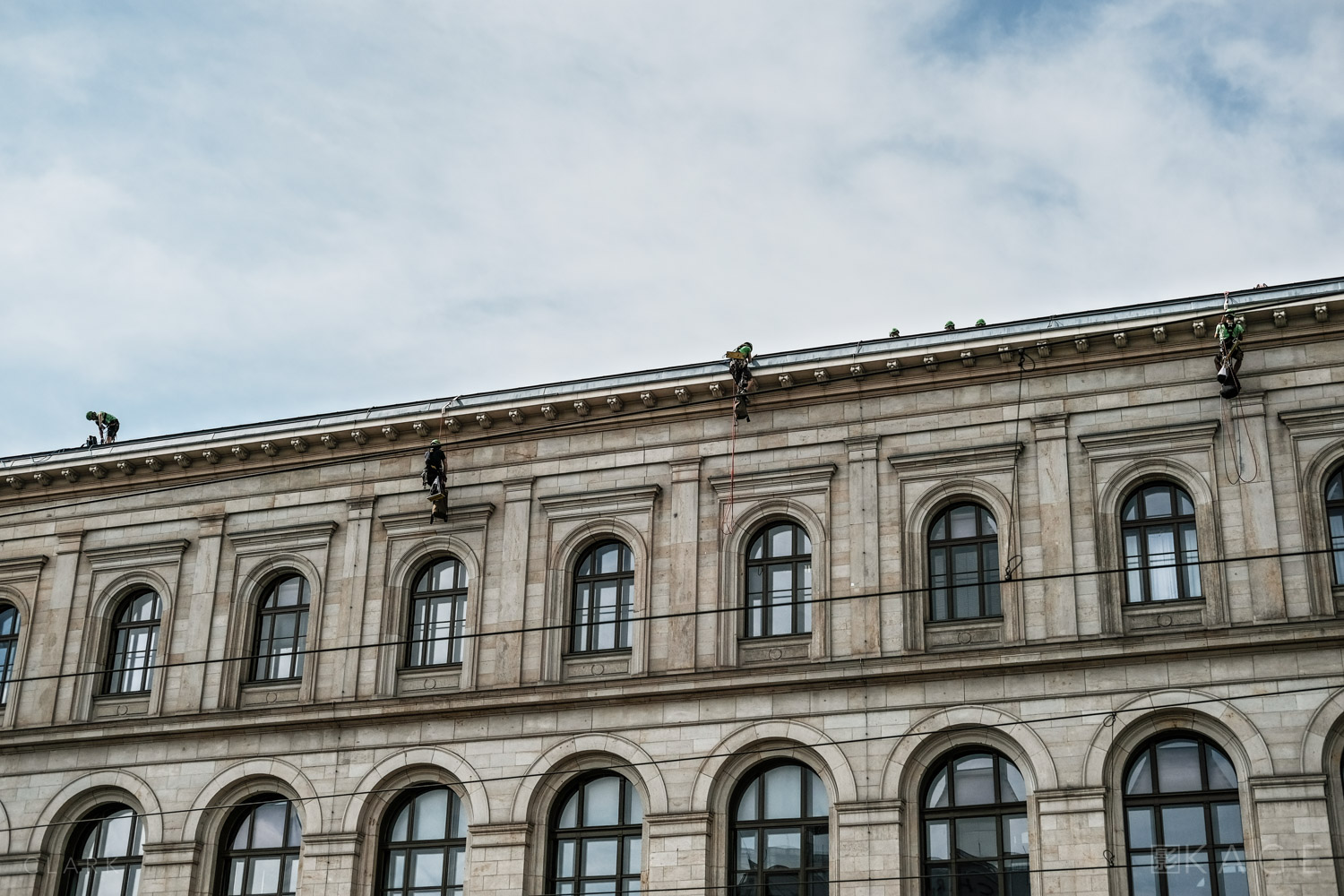 Greenpeace activists leave the roof to face police