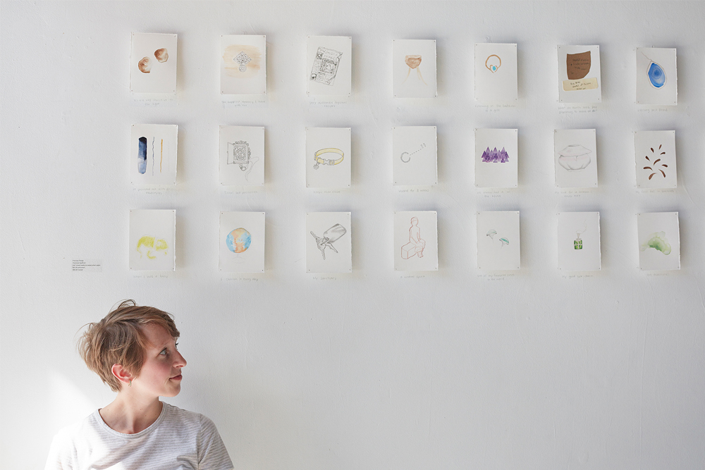 Charlotte pictured with work in the Precious Things exhibition.