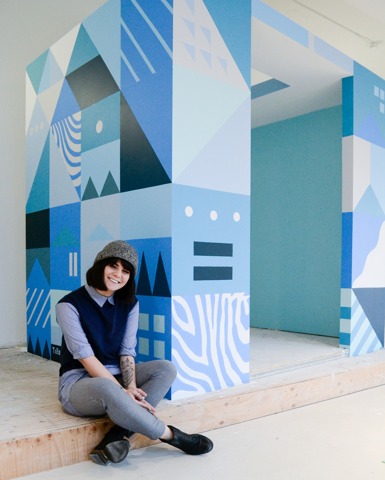 Tierney Milne  and her mural.