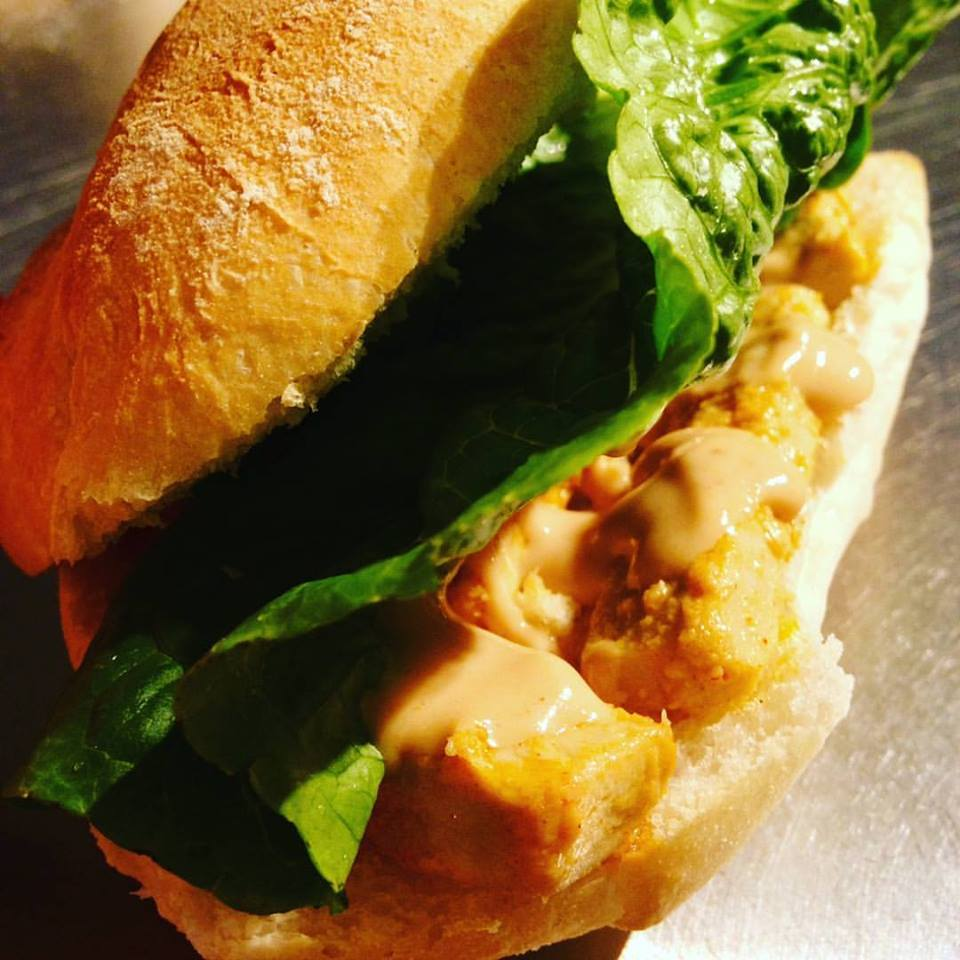 Grab-and-go vegan goodness! - Our 100% vegan sandwiches are made fresh in-house!Monday-Saturday you'll find our grilled chicken sandwiches, made with either sweet & smoky BBQ or sriracha aioli, and garnished with fresh green leaf lettuce.On Sunday we feature our much loved egg & sausage sandwich!Our sandwiches are also available for bulk and catering orders! Please inquire for our request form.