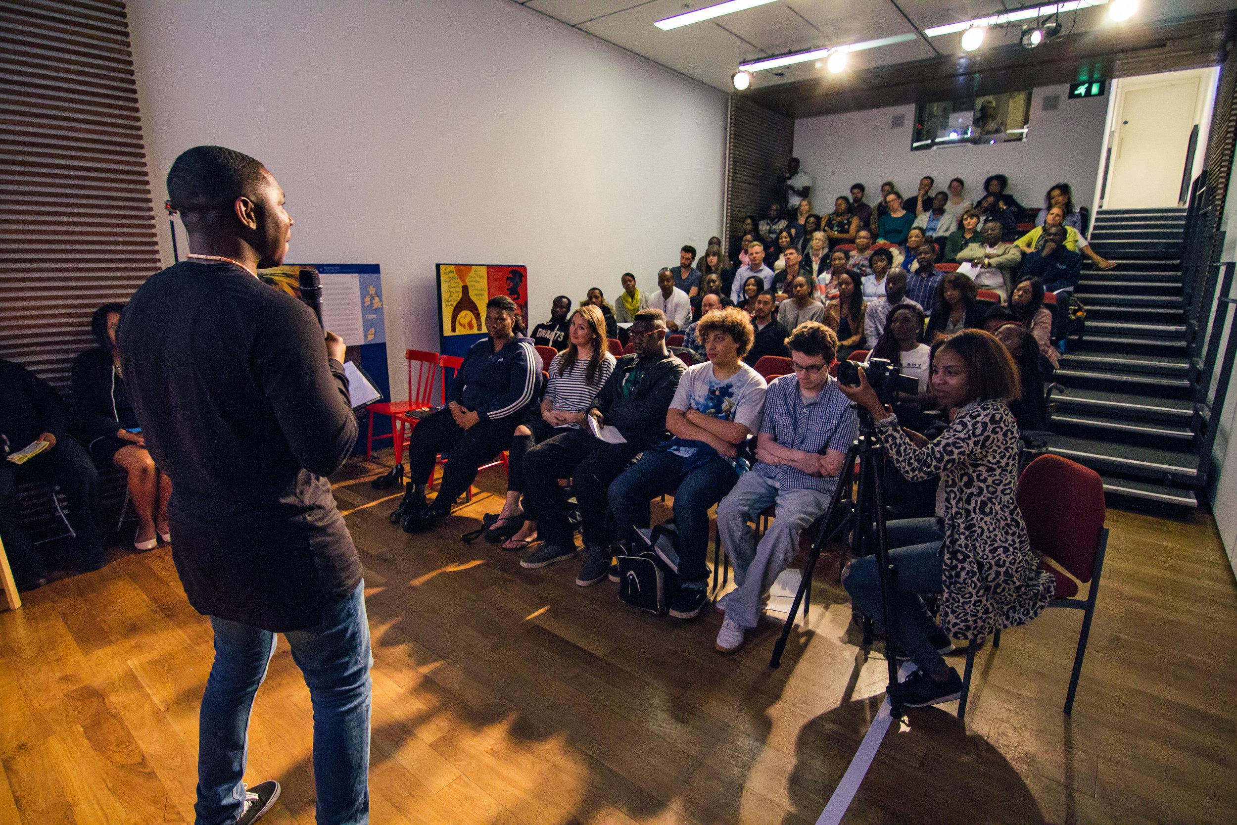 Home Is-Yomi presenting - audience shot.JPG