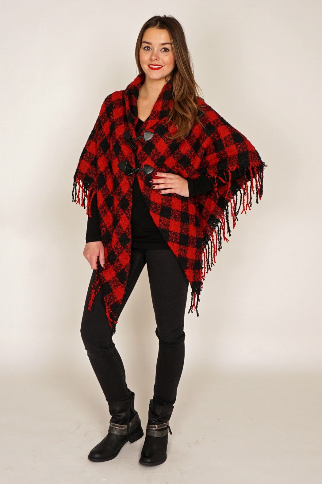 """There's always a must-have accessory that EVERYONE is obsessed with. Right now, it's all about the poncho! They're warm and cozy but stylish and chic. They can be long, cropped, colourful, or classic but every style gives such an """"I know what I'm doing"""" look. You put on a poncho and suddenly you feel more chic and put together. It works well with nearly everything in your wardrobe. Ponchos can be tailored for a chic, formal and/or professional style or be bohemian in thicker knits, colourful patterns, and/or tassels and fringes."""