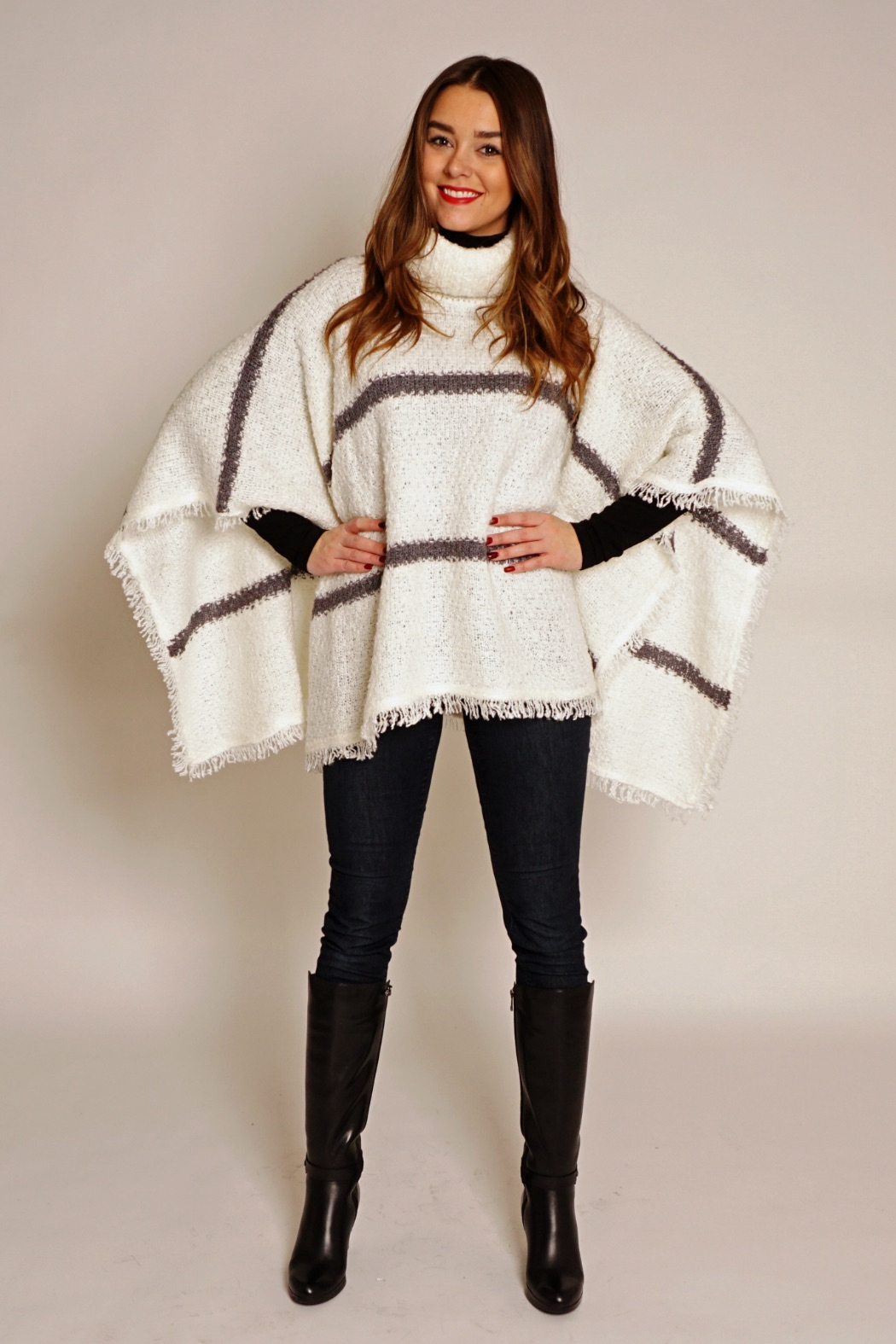 Although ponchos can appear to be an easy item to wear, it's important to choose one that fits your frame. Make sure that it is not too small or to big but that it fits your frame — otherwise you will drown in it.  Necklines such as cowl neck, turtleneck, V-neck, scoop neck, crew neck, and boat neck are great as they frame your face and upper body. While boat necks and crew necks tend to make the chest and shoulders look wider, they are perfect if you have narrow shoulders or a small bust. V-necks are especially good for women with broad shoulders or a large bust, as they have a slimming effect. If you have a longer neck, go for a turtleneck that has a shortening effect through the neck and face.  If you want to elongate your frame, opt for a ponchos that falls no lower than just above your knee. Petite ladies should be aware of long ponchos as they will overwhelm your shorter stature.The fine knit triangle-shaped poncho, in a shorter length, is perfect for smaller frames.