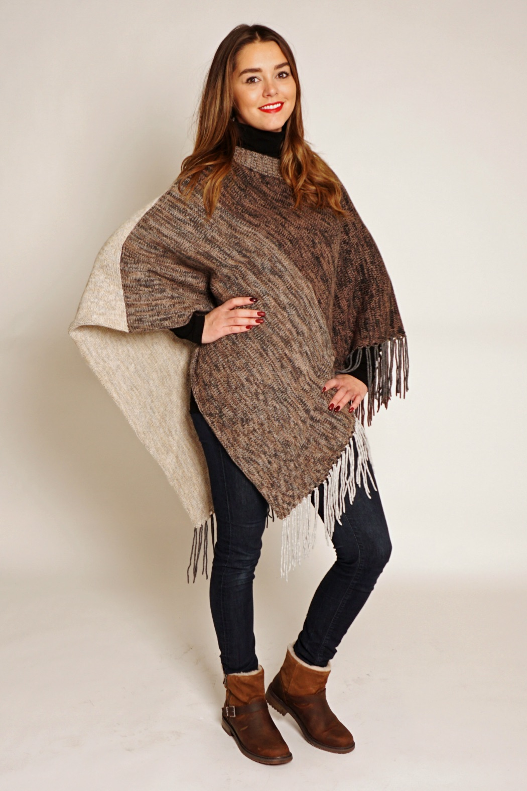 Here are just a few reasons why we think it will be a great addition to your wardrobe this season:  It's fun and trendy. The poncho or cape will add a modern touch to your wardrobe.  They are slimming and camouflage perceived body imperfections .  A poncho is super comfortable.  Wear it both indoors and outdoors: another advantage of a lightweight poncho is that you can both wear it inside the house as well as outdoors. Not all days are super cold and some days a thicker knit sweater with a poncho will do the trick.