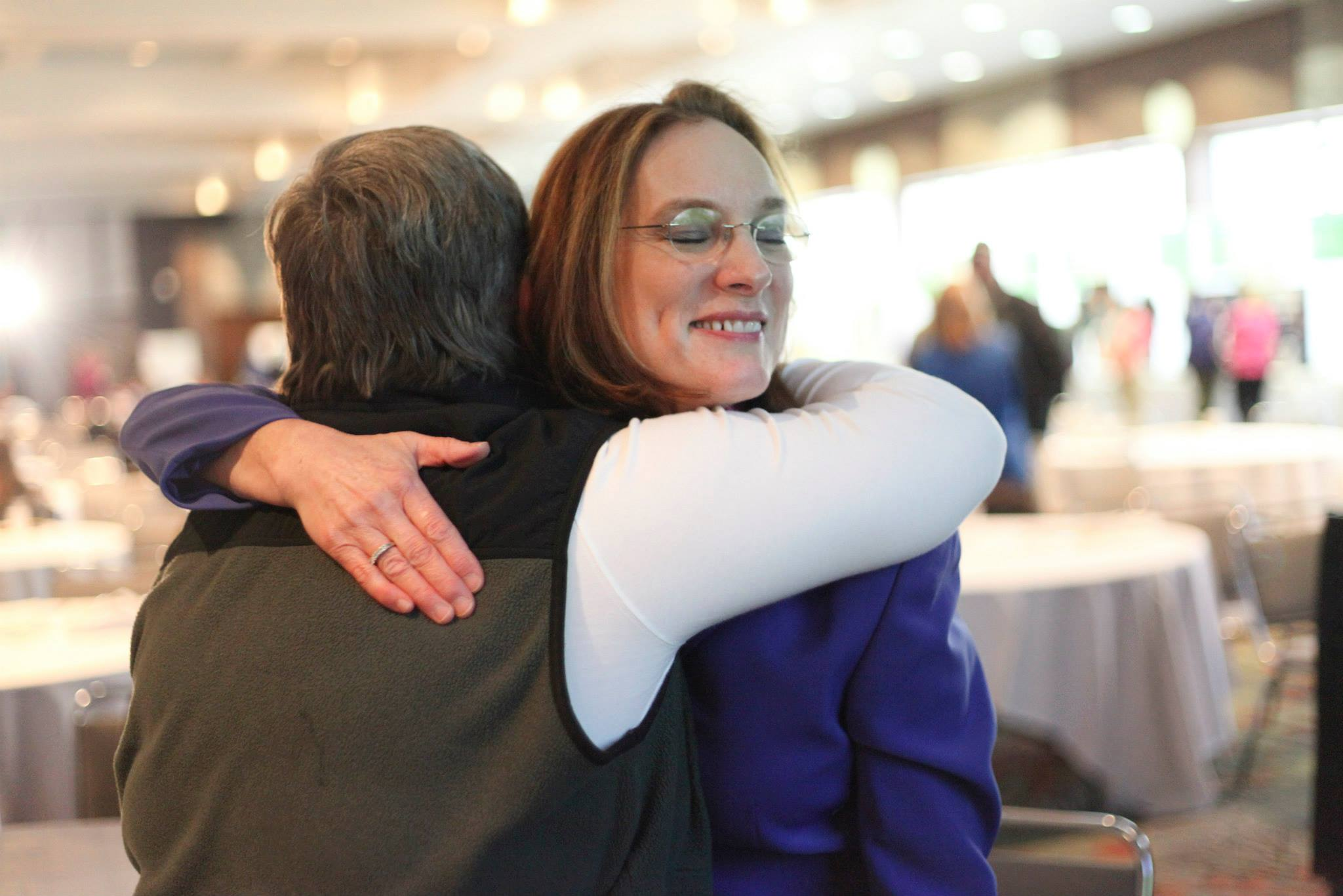 hugging attendee at essential health.jpg