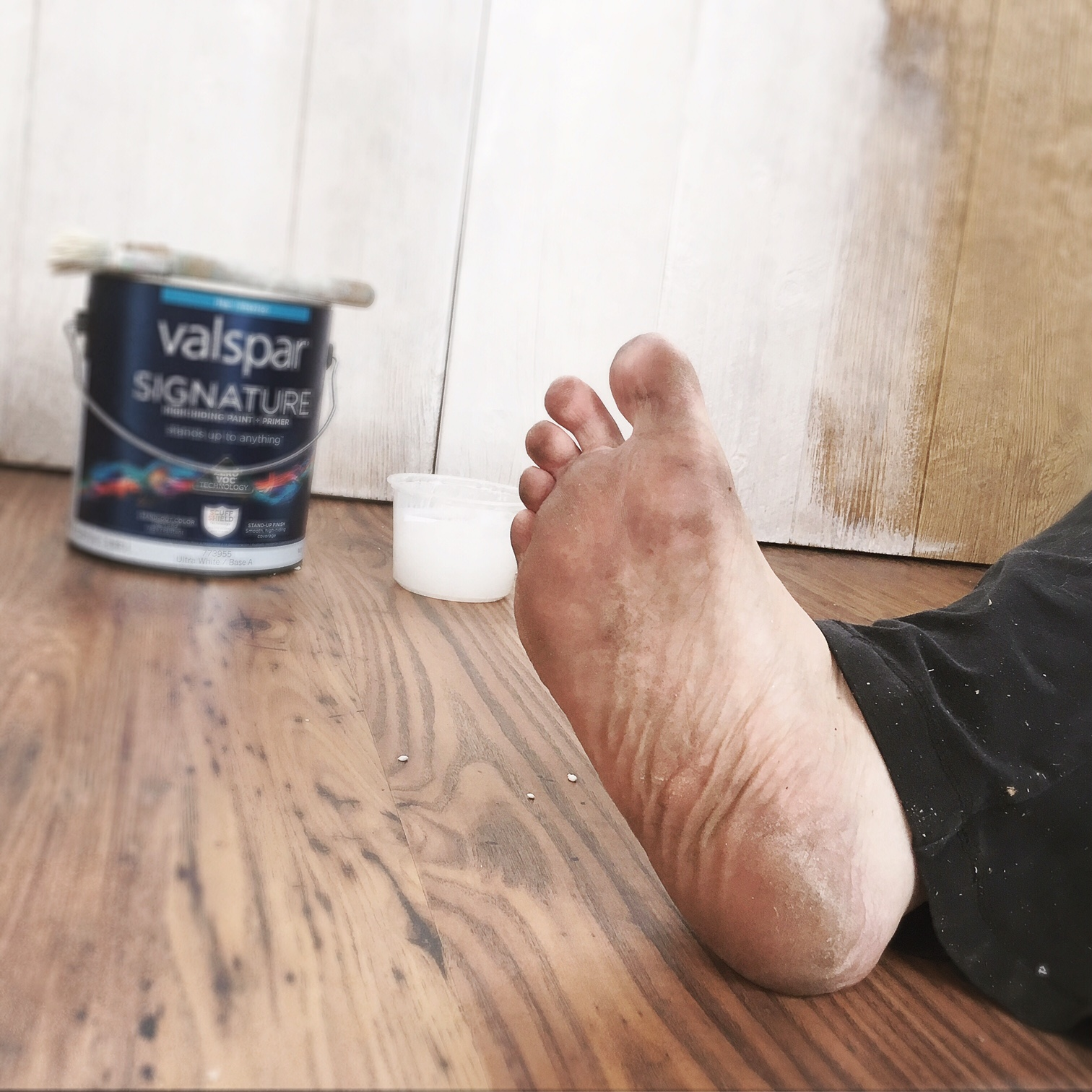 Filthy feet and white paint. The side walls are all up, and I applied a white wash technique to sell the barn wood look.