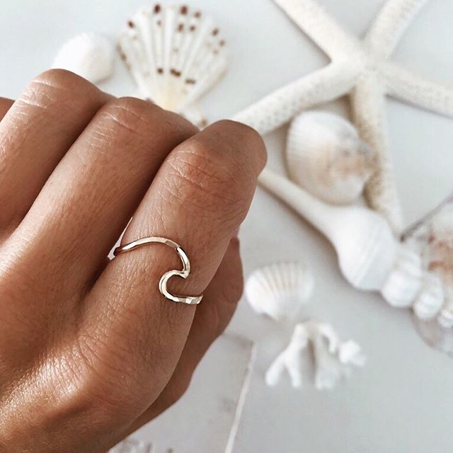 Dreaming about putting my toes in the sand, and feeling the chilly salt water splash on my feet. Maybe it's just the strong urge to get back to the coast, but this beautiful, minimal wave ring has me swooning. It's all about the waves Baby! ⠀⠀⠀⠀⠀⠀⠀⠀⠀ Ring and photo @jamesmichelle #notsponsoredjustloveit . . . . . . . . . . . . . . . . . . . #notsponsoredbutwishitwas #theoceanismymuse #mymuse #wavering #coastalvibes #coastalliving #beachvibes #surfergirl #wanderlust #supportsmallbusiness #beachchic #beachboho #seainspired #bohobeach #vitaminsea #surfstyle #summervibes #beachcomber #mermaidatheart #seayousoon #saltysoul #sandandsea #seastheday #dreamingofthesea