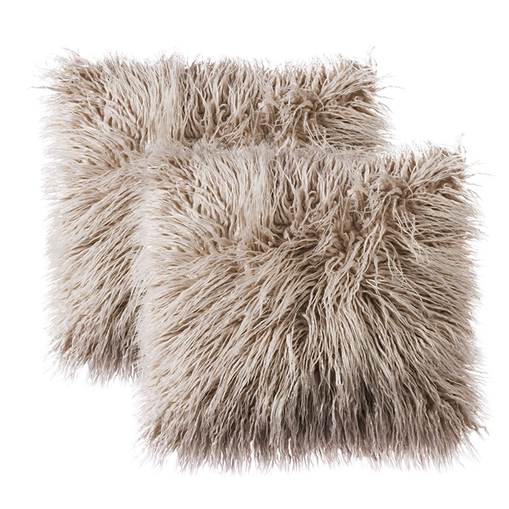 This cozy Mongolian-style  faux fur pillow  comes in a variety of colors and would add a hygge vibe to any living room.