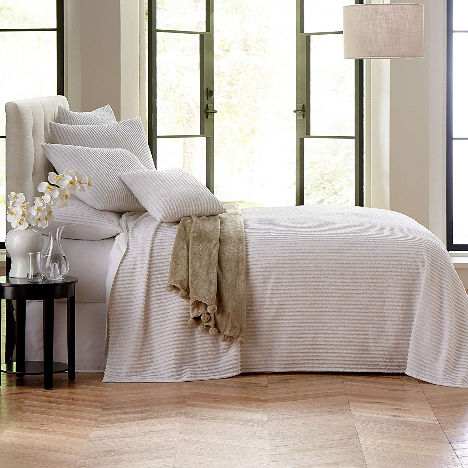 The modern clean lines of this  chenille blanket  would be beautiful in a modern farmhouse bedroom.