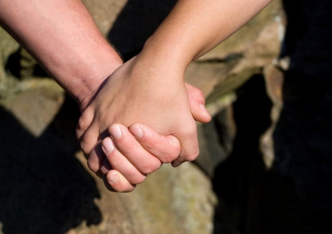 Man and Woman Holding Hands via Storyblocks.jpg