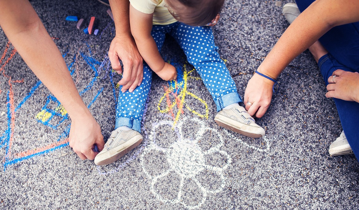 Drawing on Sidewalk with Kid and Parents by Storyblocks.jpg