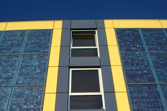 "Picture: solar panel array used as a facade on a commercial building.  ""Whilst conservative governments around the world dither about tackling climate change, commercial property landlords including some of Australia's biggest A-REITS are taking action to reduce their carbon footprints."" - Larry Schlesinger, Australian Financial Review."
