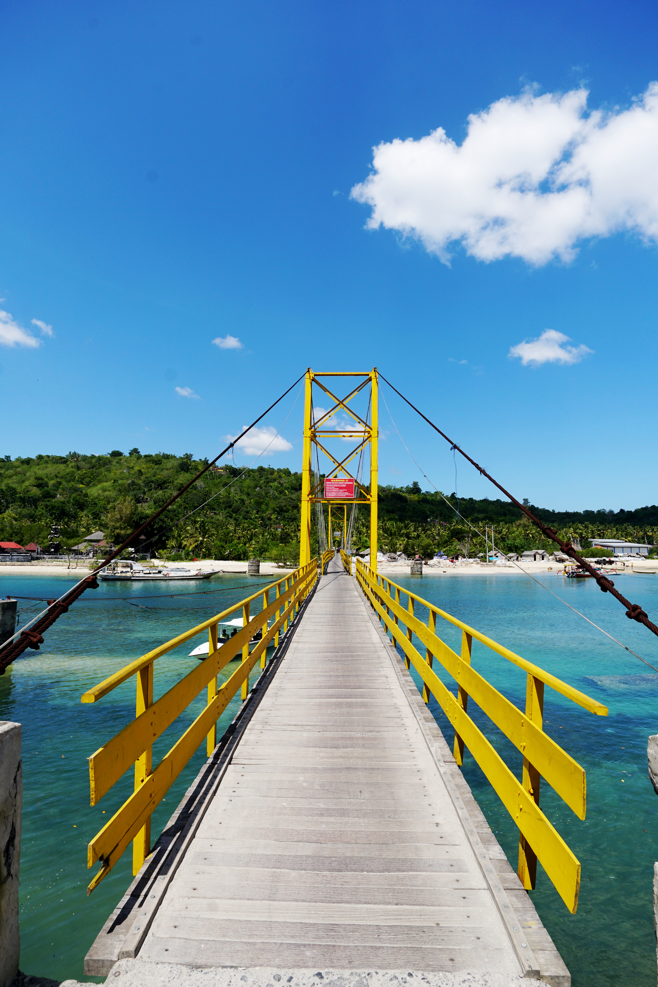 Yellow bridge connecting Lembongan and Ceningan