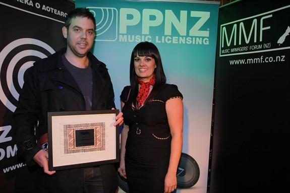 Scott Grafton winner of Upcoming Manager with presenter Tami Neilson
