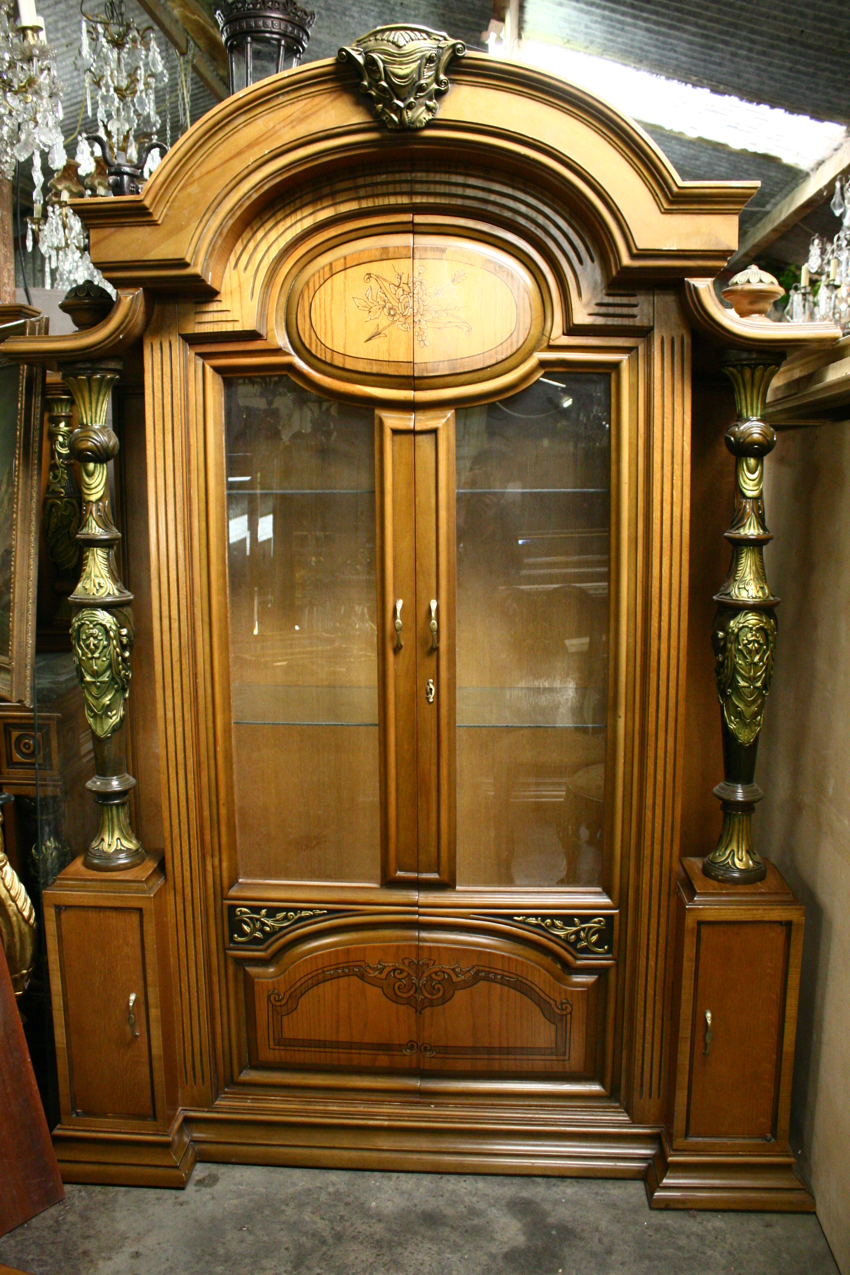 American display cabinet with solid carved wood pillars a large pediment..a good solid well made piece about 50 years old