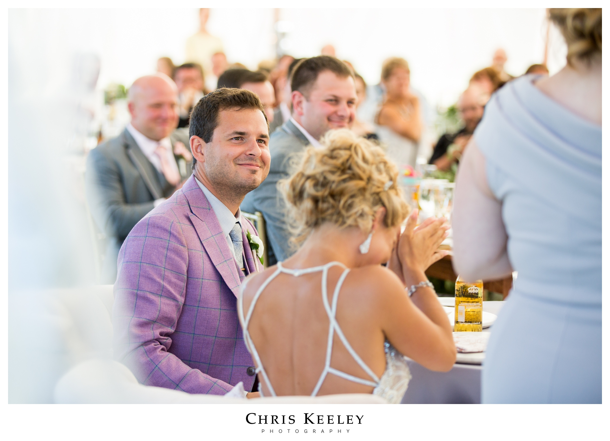 groom-smiling-at-toasts.jpg