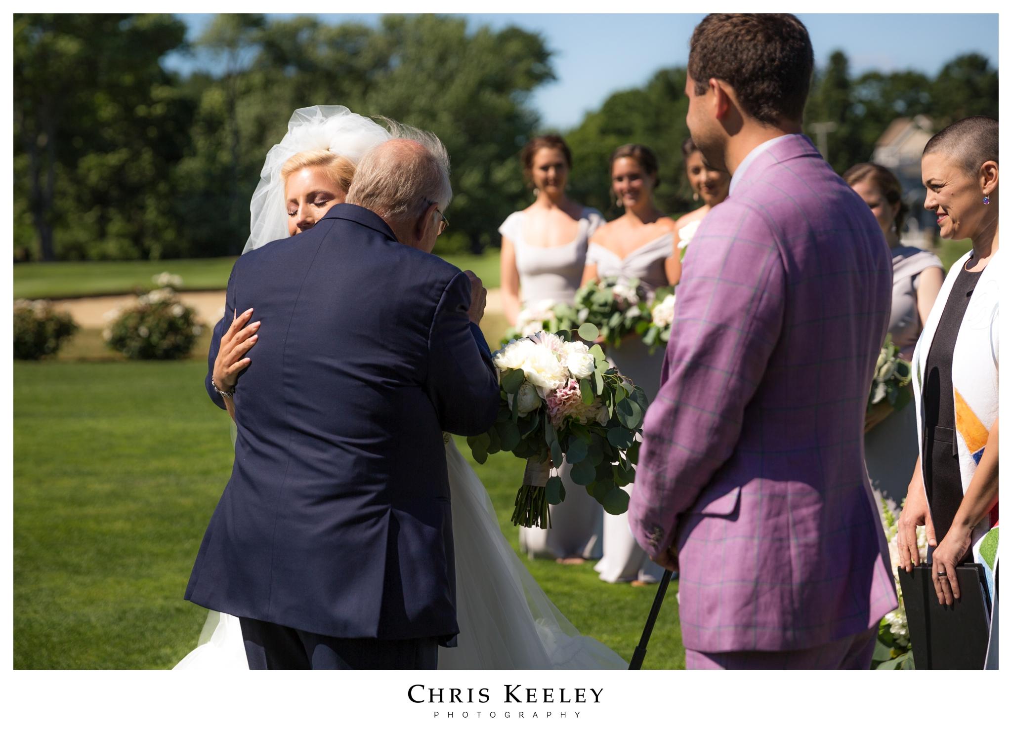 dad-hugs-daughter-at-ceremony.jpg