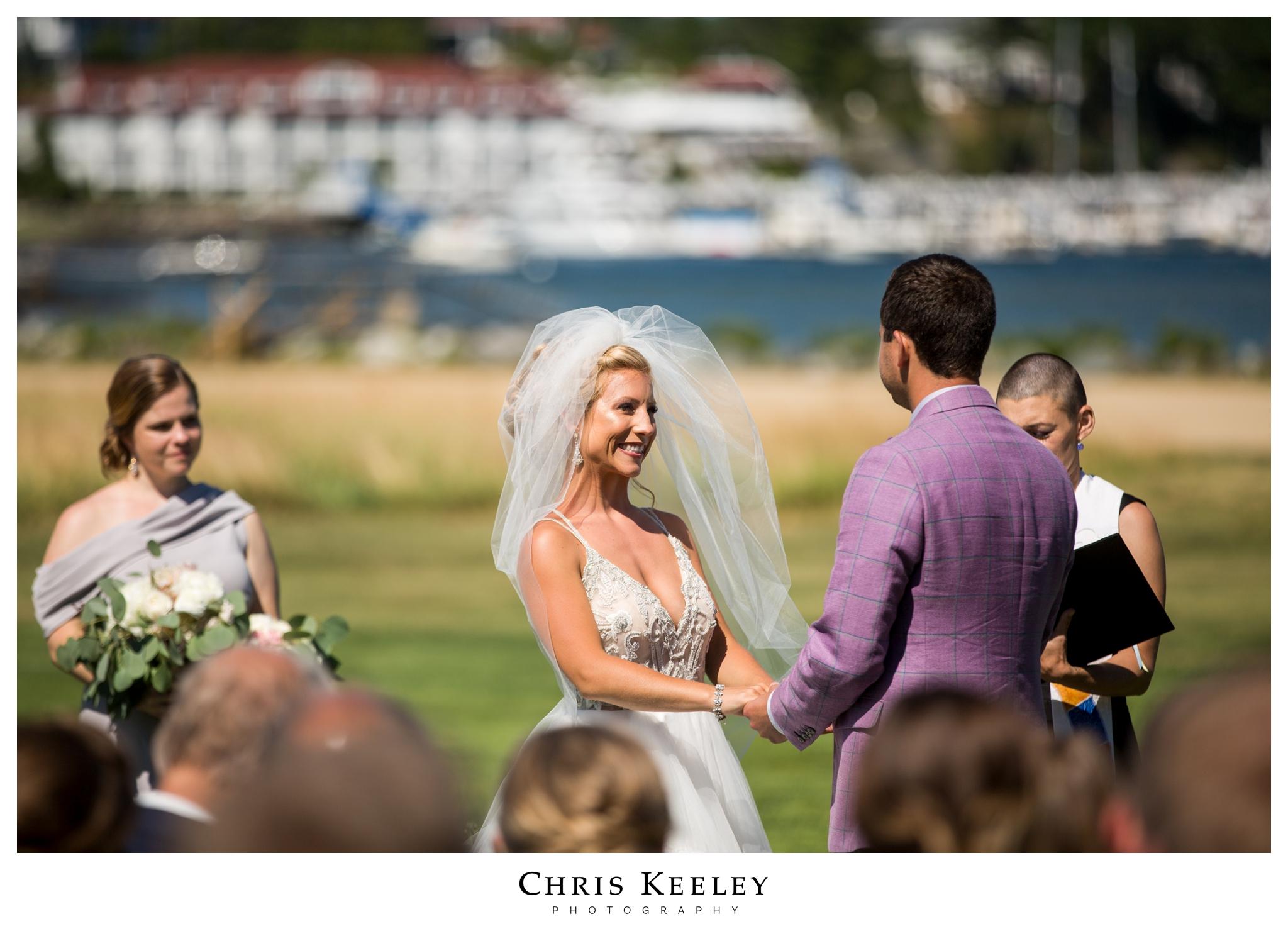 bride-smiling-at-wedding-ceremony.jpg
