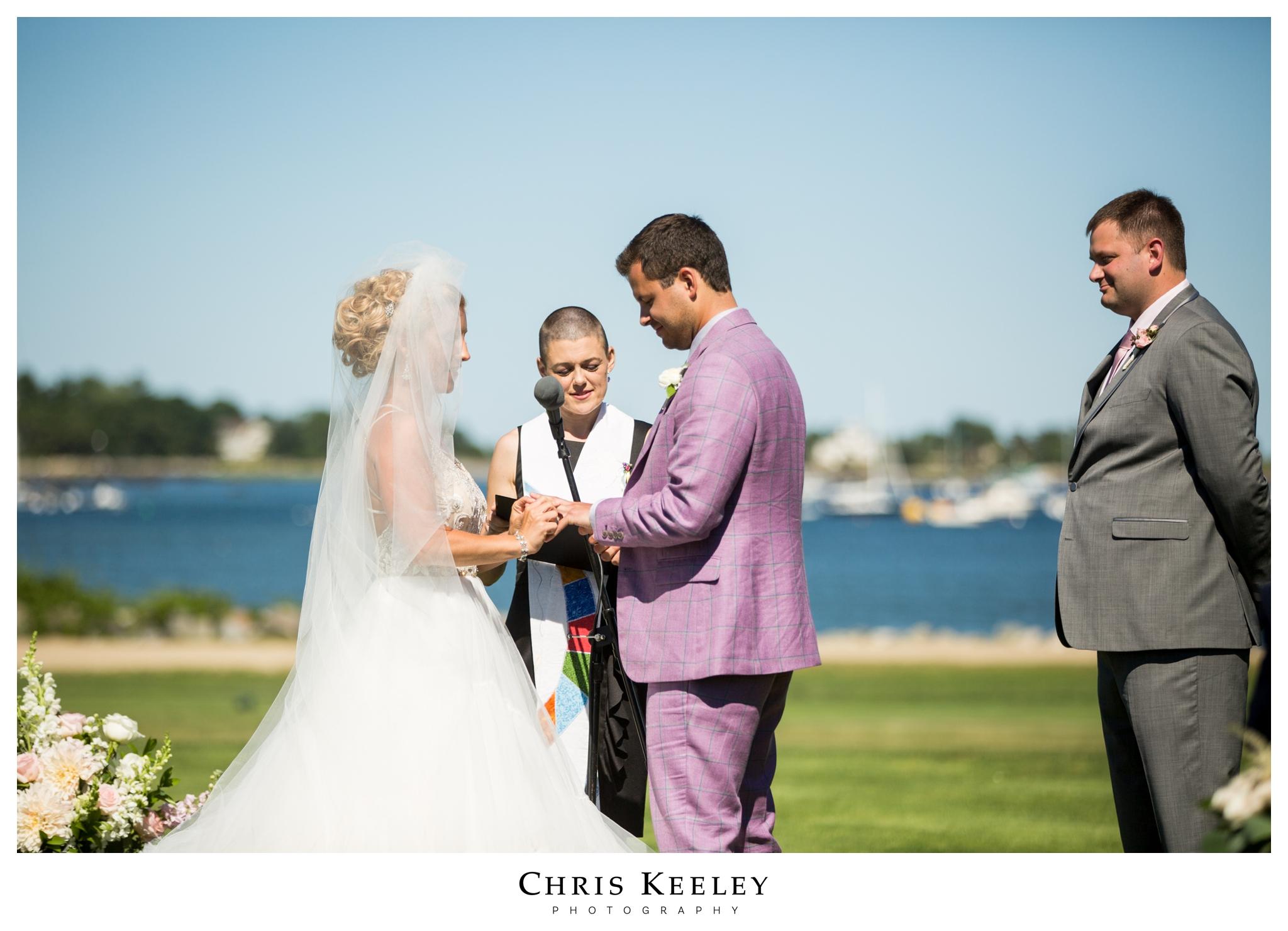 bride-putting-on-ring.jpg