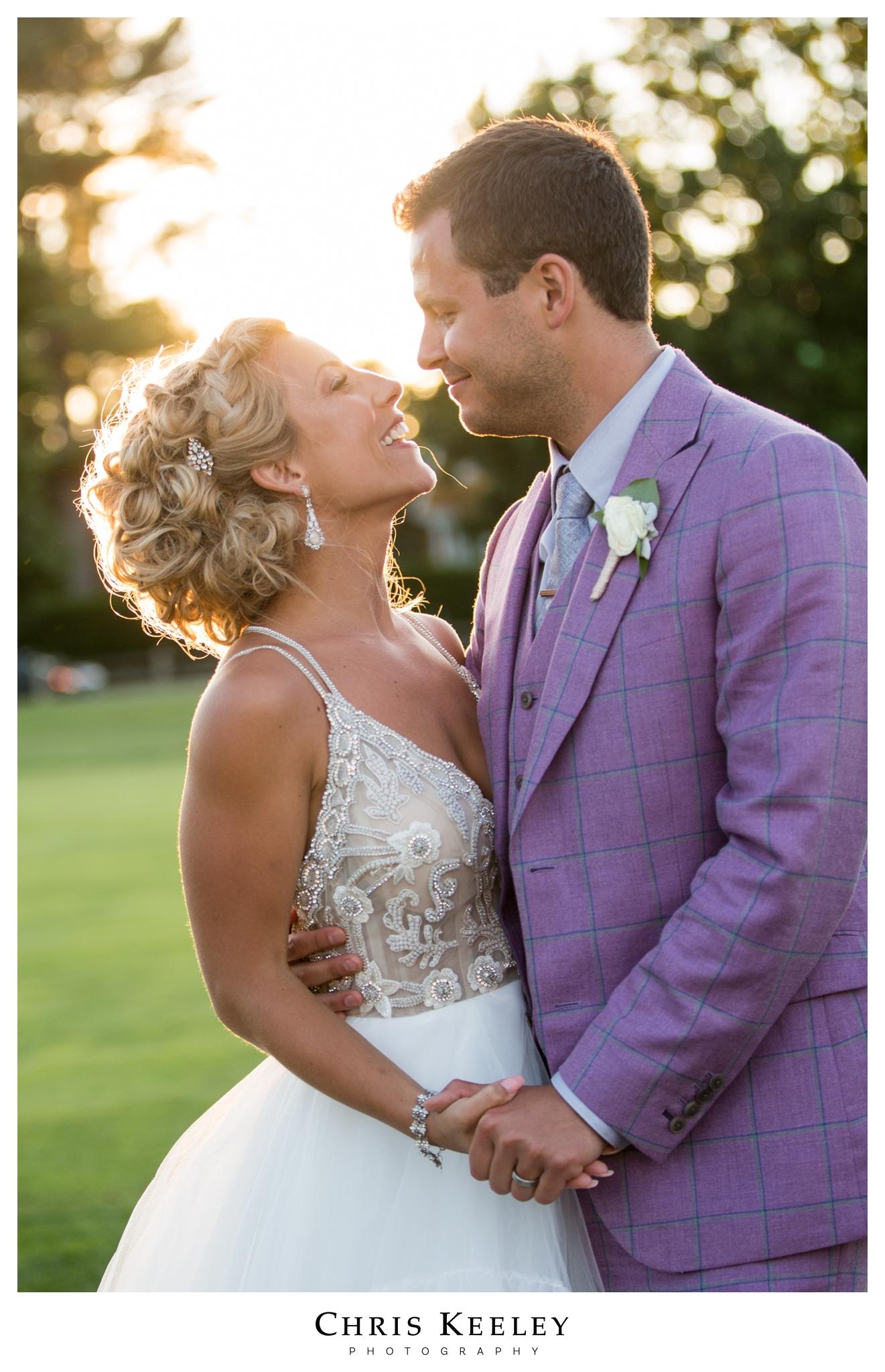bride-groom-sunset-laughing-candid.jpg