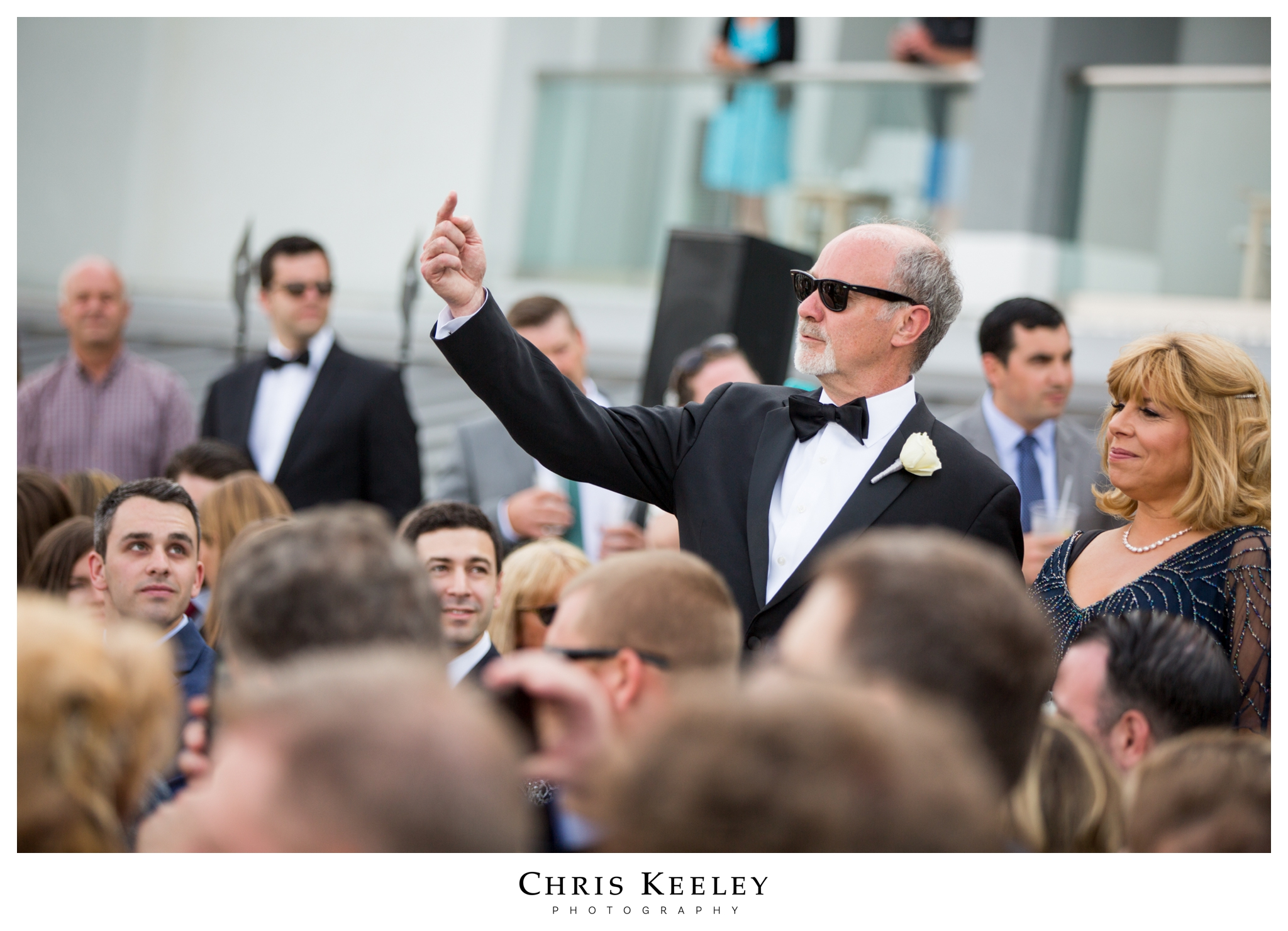father-pointing-at-son-at-ceremony.jpg