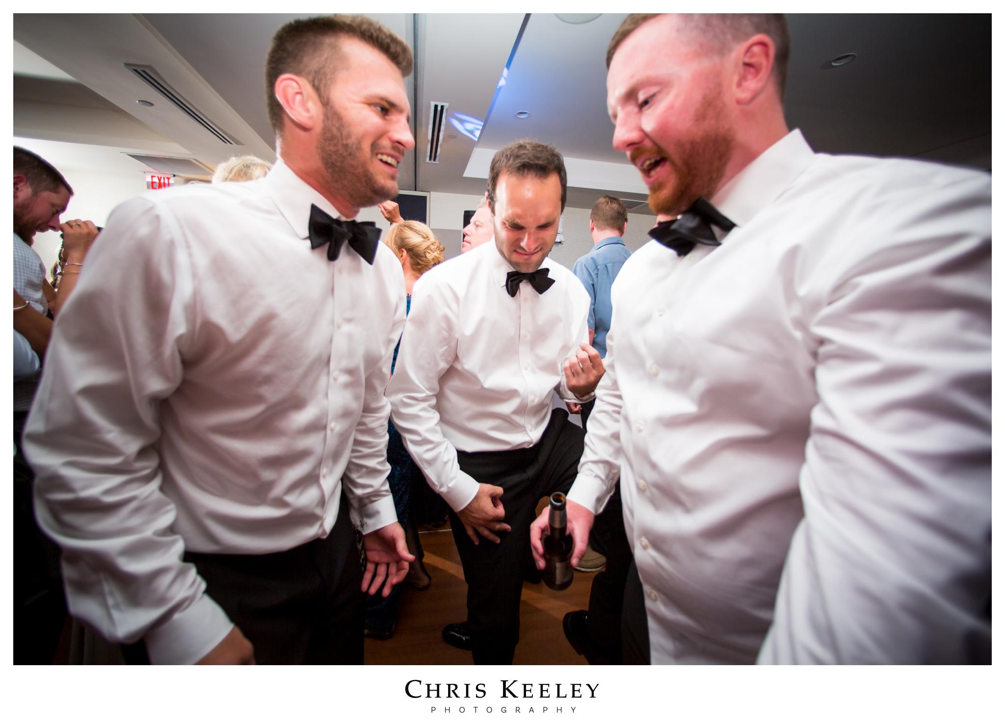 candid-groomsmen-dancing.jpg