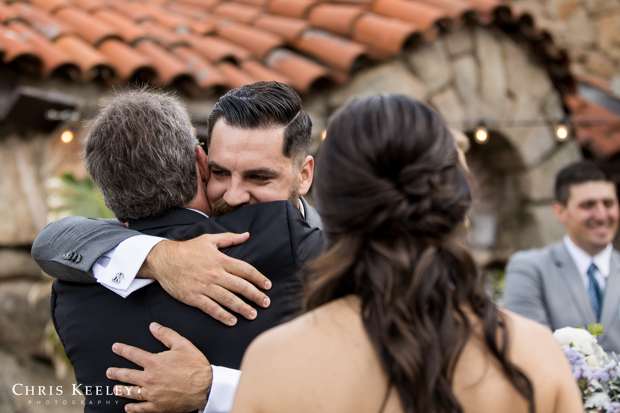 groom-hugs-dad-after-ceremony.jpg