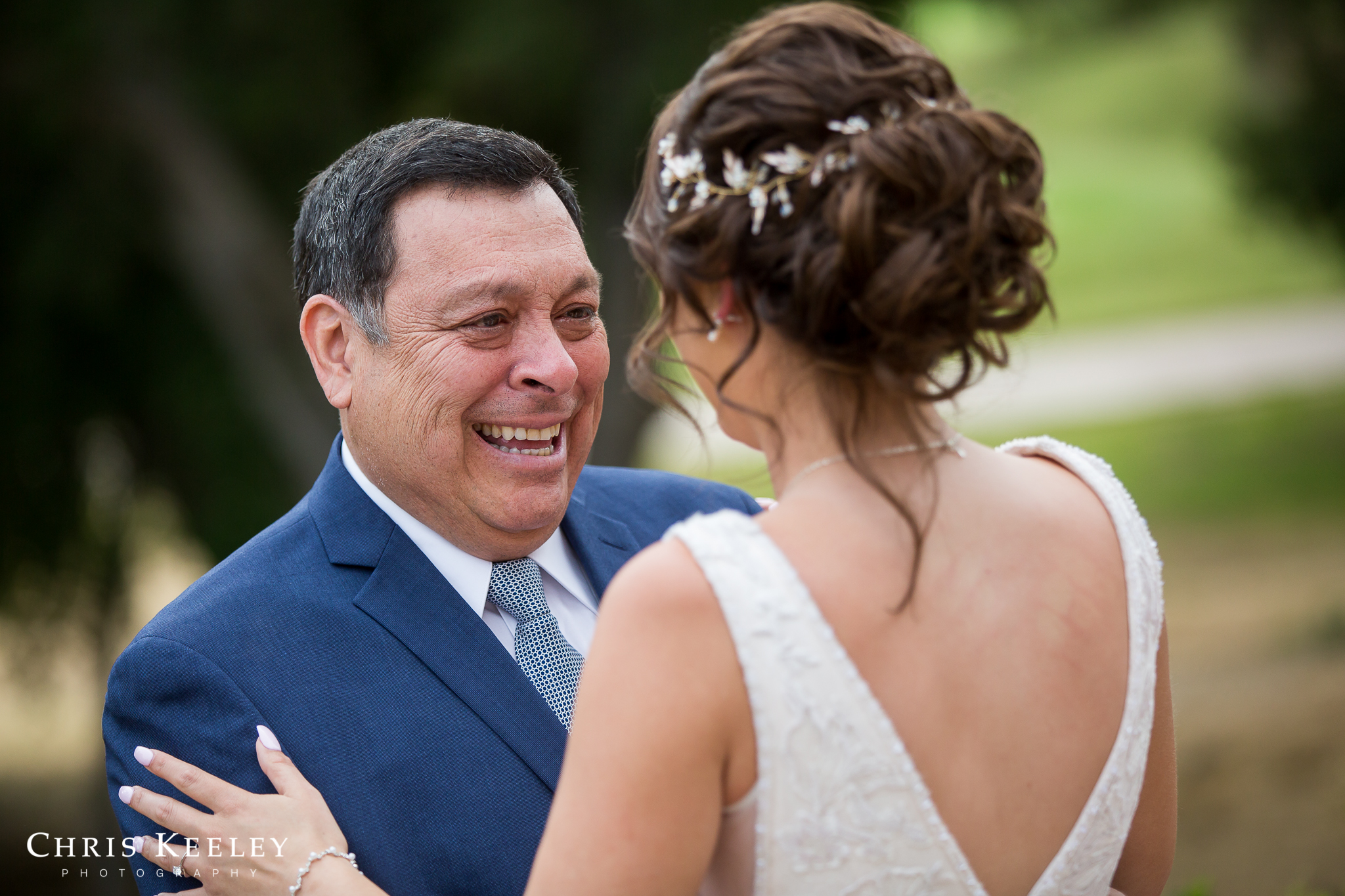 father-cries-and-smiles-at-bride.jpg