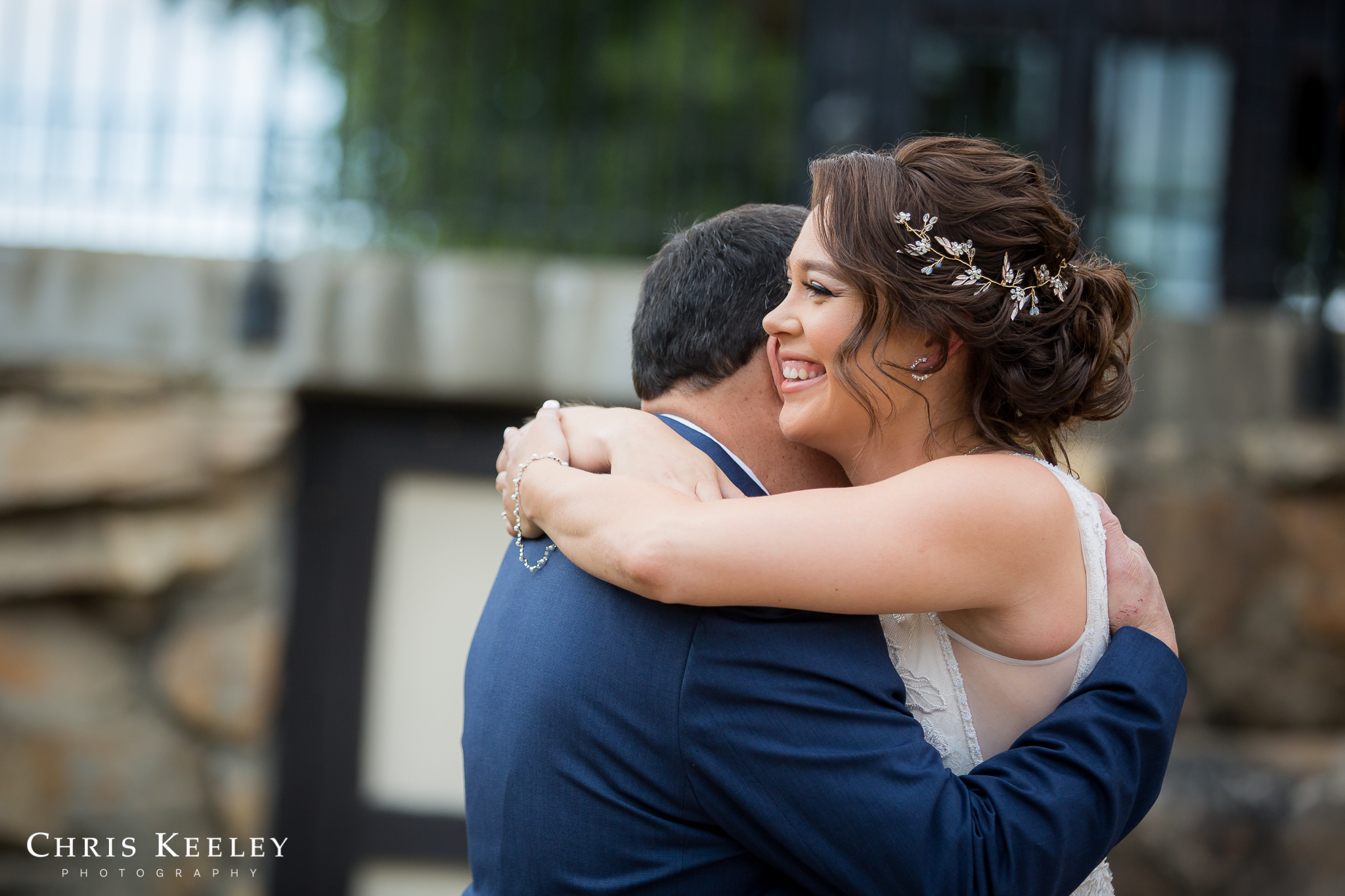 bride-hugs-father-and-smiles.jpg