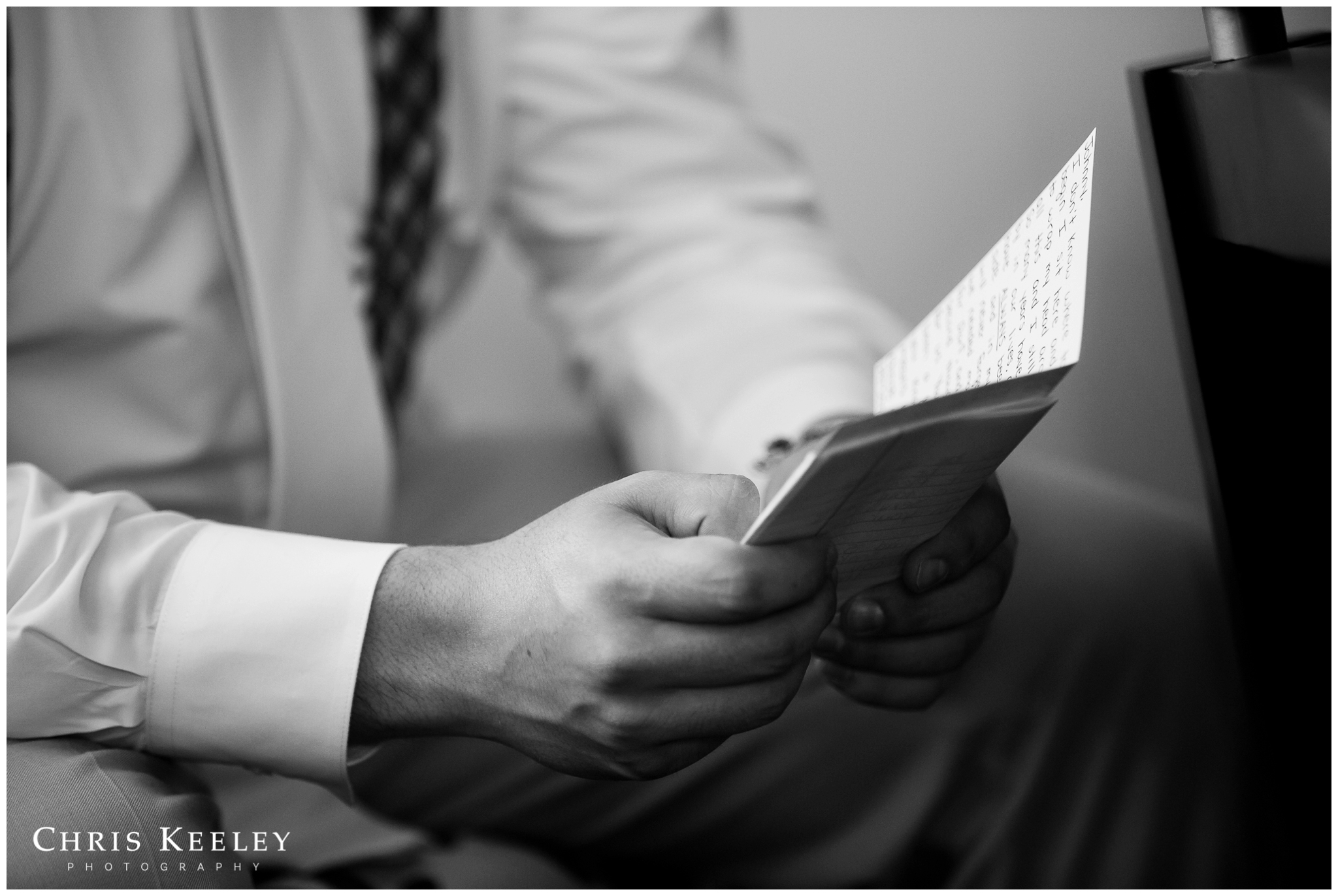 up-close-of-groom-reading-card-from-bride.jpg